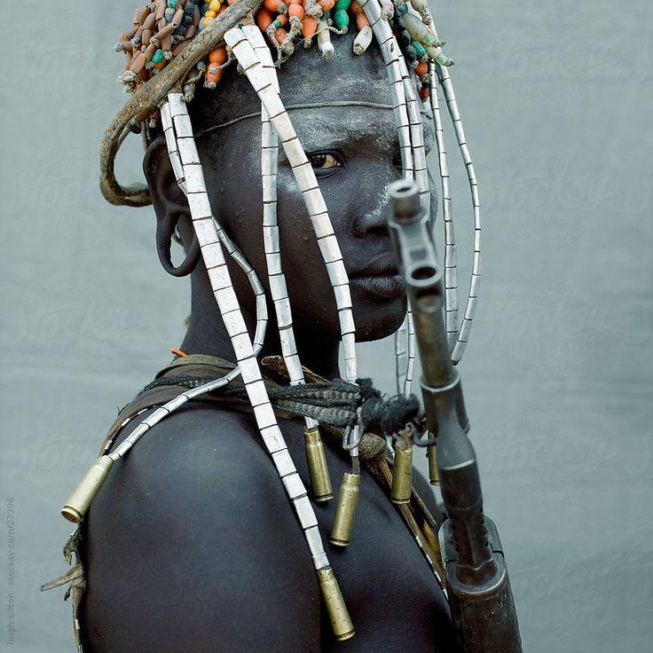 Mursi tribal woman adorned. Ethiopia by Hugh Sitton for Stocksy United  https://www.stocksy.com/27396