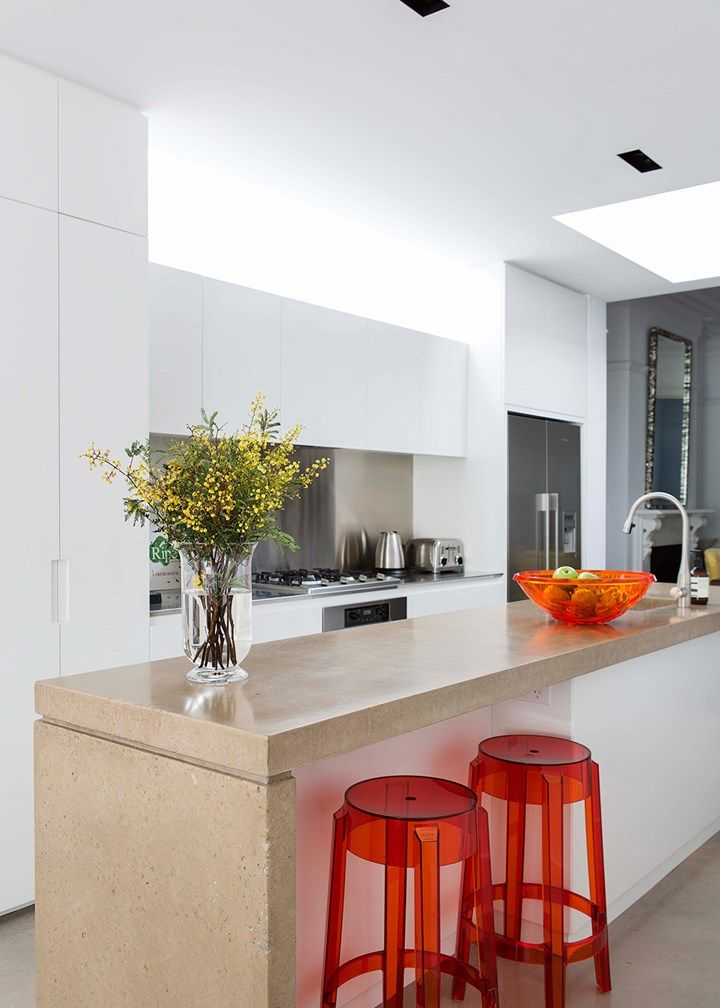 Kitchen with red stools   Home Beautiful Magazine Australia