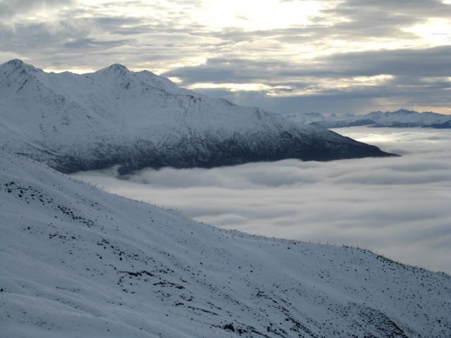 NZ, snowboarding above the clouds.