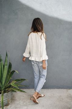 white smock top, boyfriend pale jeans, slip on shoes
