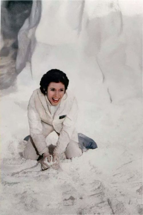 Carrie Fisher playing in the fake snow on the set of Empire Strikes Back