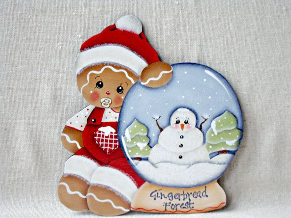 "Gingerbread Fridge Magnet, Baby Gingerbread in Red Snowsuit with Gingerbread Forest Snow Globe. designed by Pamela House, painted by ""me"". Available at: Etsy: ByBrenda'sHand: Ebay: CherishedAtticTreasures: Facebook: Cherished Attic Treasures."