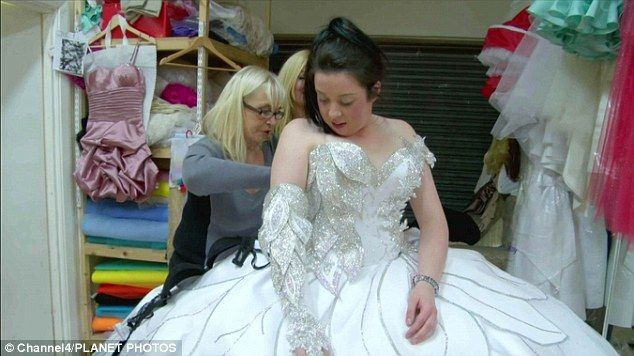 Wedded to fantasy: Thelma Madine puts the finishing touches to bride Bridget's lavish dress    Read more: http://www.dailymail.co.uk/news/article-2106575/How-20st-wedding-gowns-Gypsy-dressmaker-fortune.html#ixzz1twmiKXJQ
