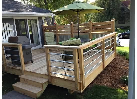 Cedar and Corrugated Fence with Conduit Pipe Rail