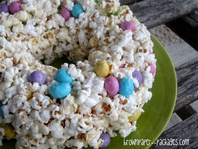 {popcorn cake}    10.5 oz. package of marshmallows  16 c. popped popcorn (a little less than 3/4 c. unpopped)  1/4 c. butter  1 large bag Peanut M's (I used the Easter ones!)