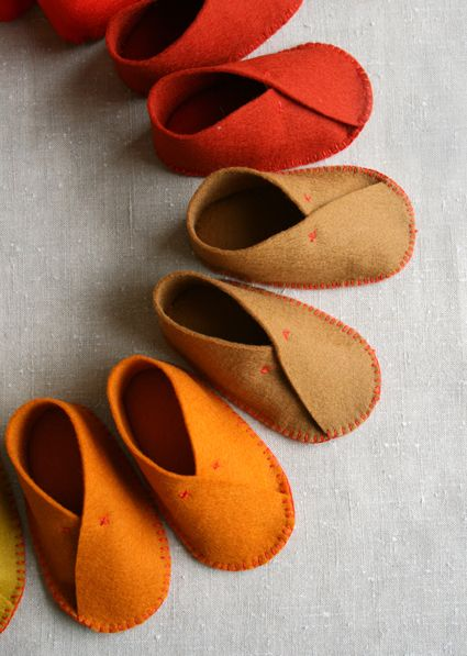 diy baby felt shoes - Have to dig through archives to find pattern, but use this as an example. Might work to reinforce at top with an elastic behind.