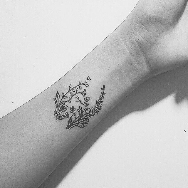 """""""She had a flower tattoo on her wrist; """"What does that mean?"""" he asked her. """"Absolutely nothing, """"she said, """" it's just a flower. """""""
