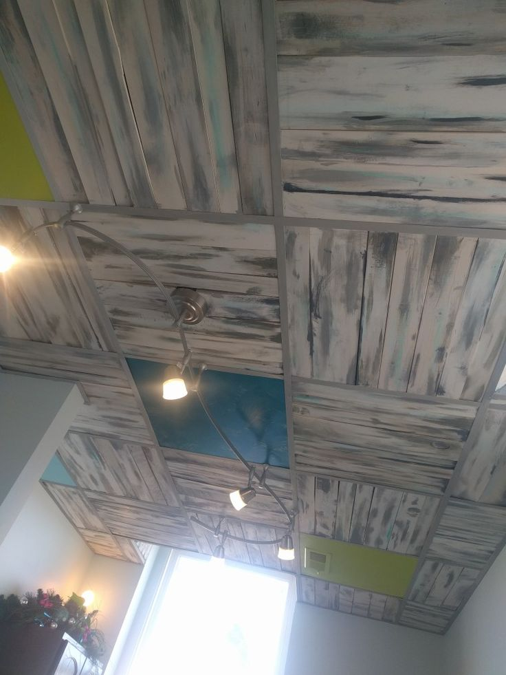 diy pallet board ceiling in place of drop ceiling tiles!