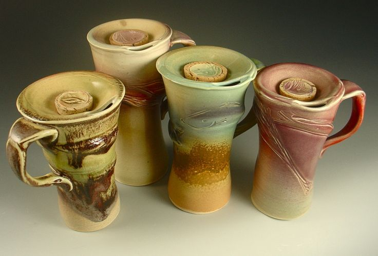 Travel Mugs-Experiments Say whaaat?! I need to try and make these! I always just cram my mugs in the car cup holders and let them slosh around. This could be very very cool!