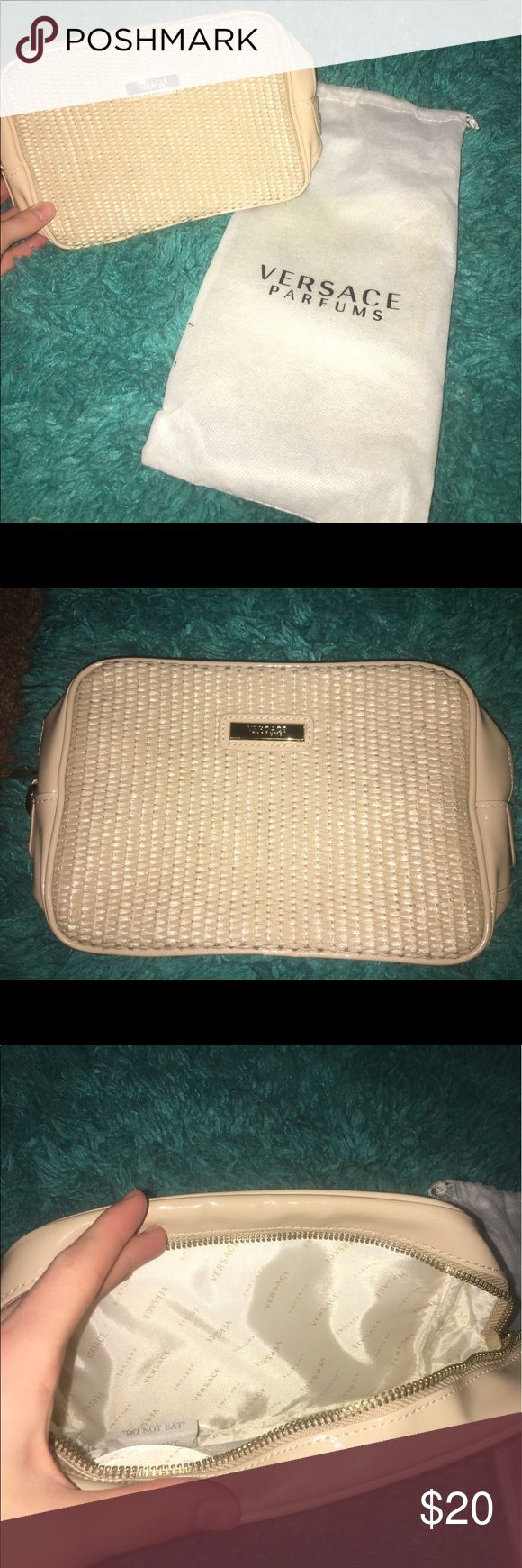 Gold Versace parfums bag This small makeup/cosmetic carrying case has never been used, brand new and comes with the dust bag. Versace Collection Bags Cosmetic Bags & Cases