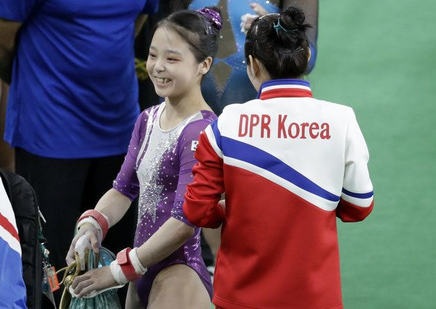 The simple photo at a women's training session is poignant because gymnast Lee Eun-ju is from South Korea and her competitor, Hong Un Jong, is from North Korea.