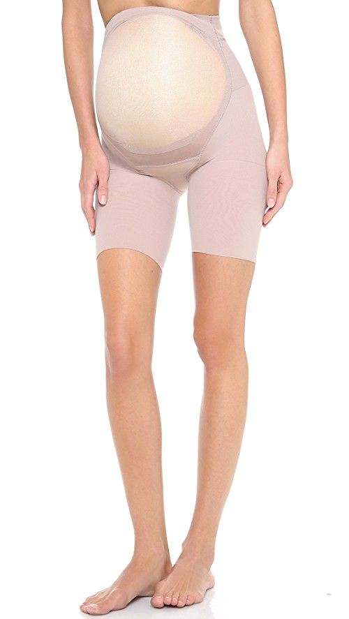 SPANX Power Mama Maternity Shaper | Slimming support for expectant moms, this maternity mid-thigh smoother features an under-belly support and a soft tummy panel. Sleek, cling-free finish. No panty lines. Legband-free design prevents bulges on thighs. 81% nylon/19% spandex. Hand wash. Made in the USA.