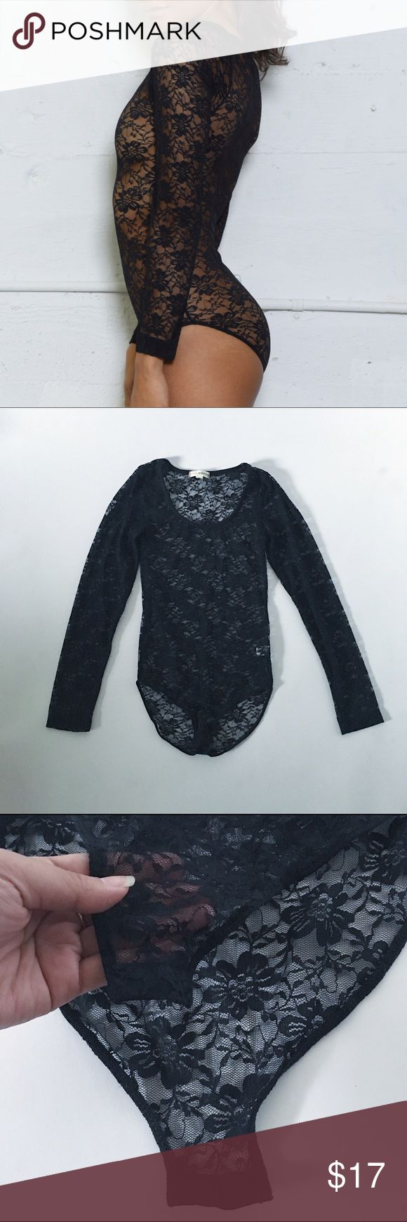 Sexy Black lace leotard long sleeve body suit Black lace long sleeve leotard NWOT New without tags Never worn Snaps at bottom for easy removable  Black Floral , bodysuit Tops