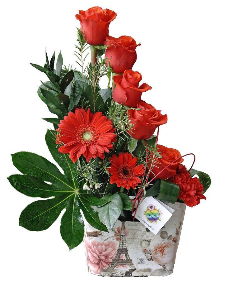 Aranjament realizat din trandafiri gerbera garoafe wax flower ruscus aspidistra…
