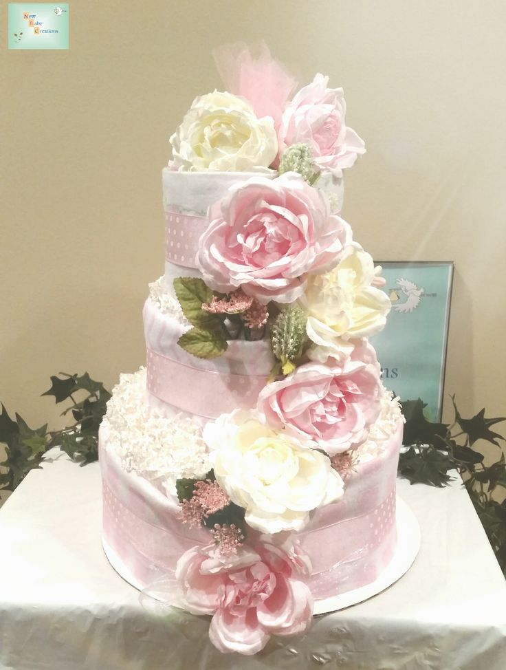 My new 3-tiered elegant floral diaper cake containing approximately 51 diapers and 3 receiving blankets.
