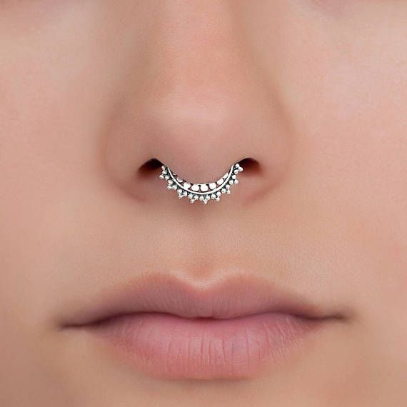 Beautiful tiny Tribal, septum ring. Ethnic, delicate design. Can be worn as an earring for the tragus, cartilage, helix, septum or as a nose ring. Available in Gold plated Sterling silver, Brass And Sterling silver. (use the scroll bar to choose the material). Thickness: 0.8 mm - 20