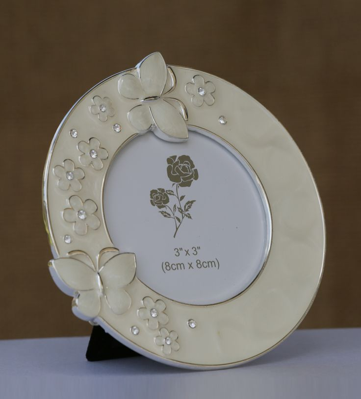 Photo Frame with Round Butterfly Border - A wonderful frame with white flowers and butterfly, semi circling the space for your photo, preciously spreading the magic through its captive charm.