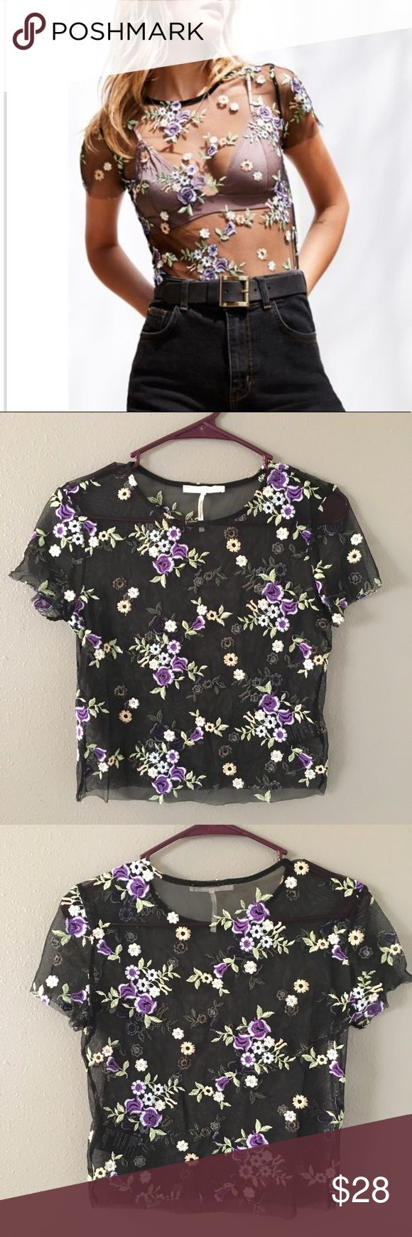 Urban Outfitters sheer top - NWOT Urban Outfitters sheer top with flowers sewn on. Never worn. Ordered online from UO. Edges are left raw and when the flowers are near the edges they are more subject to fraying and that is how it arrived as shown in picture 6.   Perfect for festivals: Coachella, EDC, EDCLV, Vegas, spring fashion, summer fashion, festival season Urban Outfitters Tops