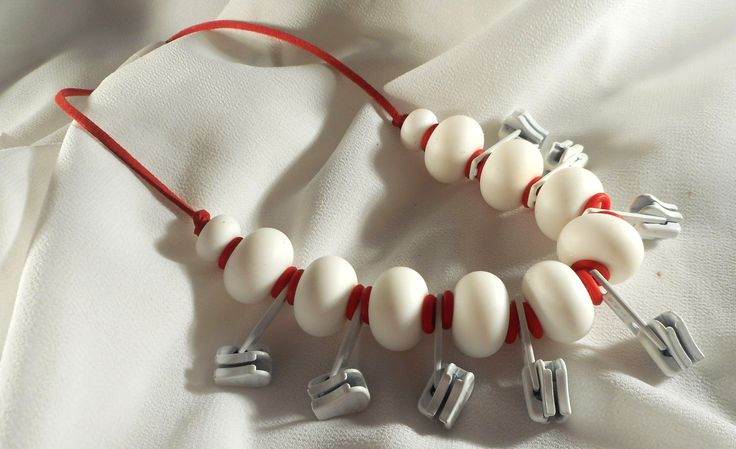 JakDesigns White zip necklace Be brave, be bold and wear a statement in white and red.$50