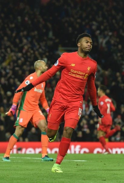 Liverpool's English striker Daniel Sturridge celebrates scoring their fourth goal during the English Premier League football match between Liverpool and Stoke City at Anfield in Liverpool, north west England on December 27, 2016. / AFP / Paul ELLIS / RESTRICTED TO EDITORIAL USE. No use with unauthorized audio, video, data, fixture lists, club/league logos or 'live' services. Online in-match use limited to 75 images, no video emulation. No use in betting, games or single club/league/player…