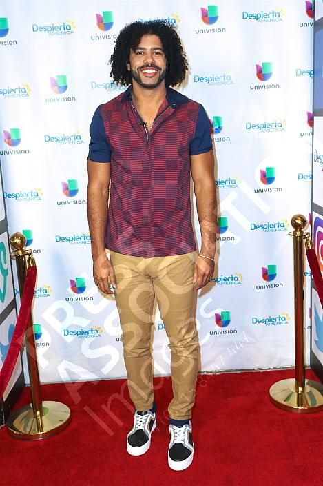 Daveed Diggs wearing the Pierre Hardy 'Basket Campus 2' sneakers to 'Despierta America' in Miami Florida on November 7, 2017