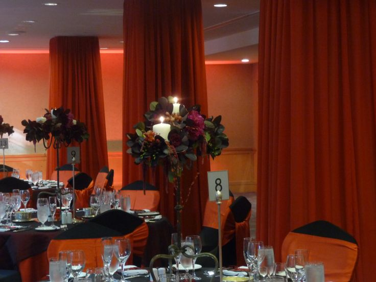 Red pillar draping and black candelabra with florals. Styled by Greenstone Events.