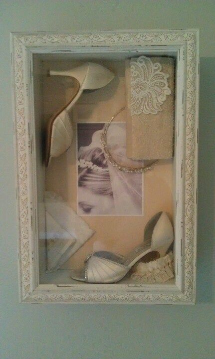 Shadowbox I created with shoes, tiara, handkerchief, purse, and garter from our wedding day. On the inside, I also included a photo of me getting ready and a hidden typed explanation of the importance and sentimental explanation of each item.
