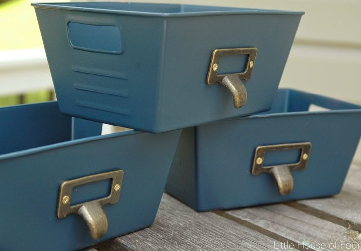 Inexpensive Dollar Store bins get an update with spray paint and gold metal pulls.