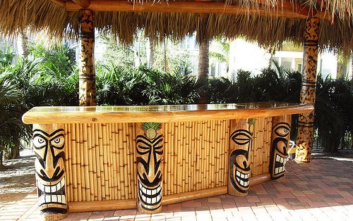 tiki bar with laughing tiki totems ~ Tiki bar = always makes me smile!                                                                                                                                                      More
