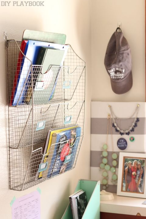 Hang folder organizers using command strips to keep your college dorm room walls hole free!