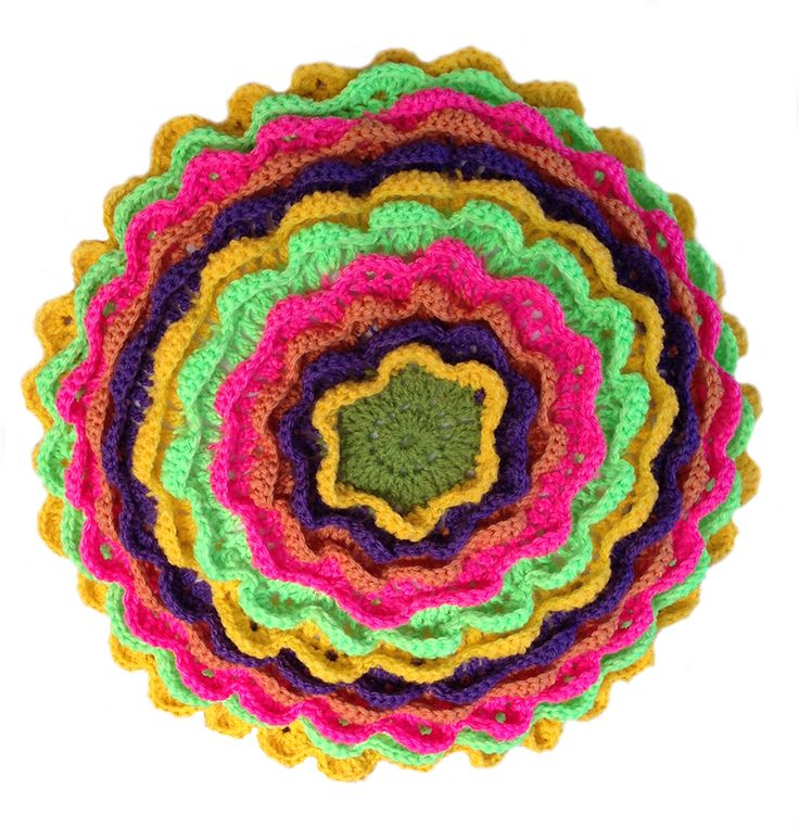 Round crochet cushion - multi coloured. Plain crochet back