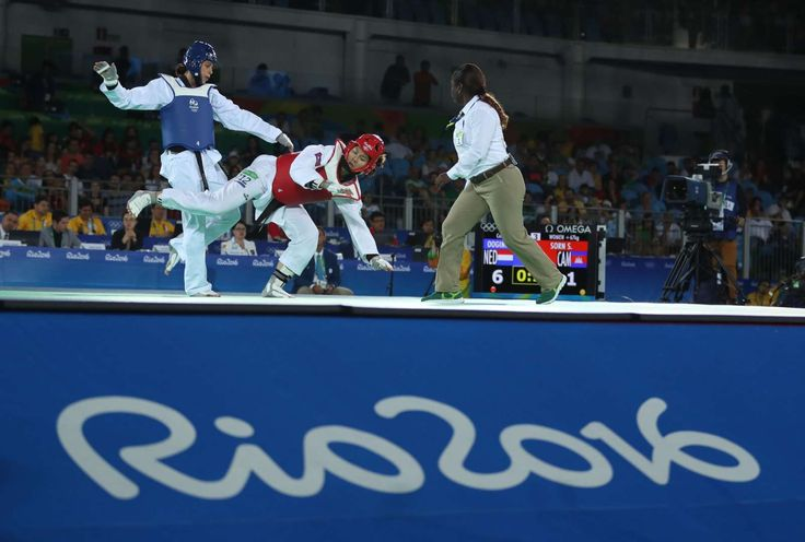 Reshmie Shari Oogink of the Netherlands competes against Seavmey Sorn of Cameroon in a women's taekwondo +67kg round of 16 taekwondo match during the Rio 2016 Summer Olympic Games at Carioca Arena 3.   -  Best images from Aug. 20 at the Rio Olympics