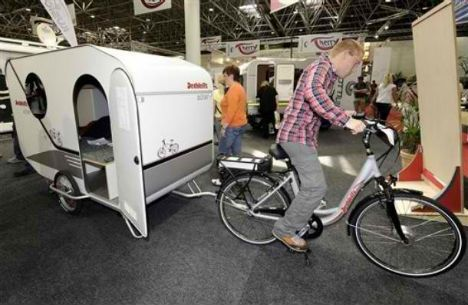Bike Campers: 12 Mini Mobile Homes for Nomadic Cyclists—German RV maker Dethleffs experimented with a concept bike camper, producing a prototype that included a bed and a small kitchen.