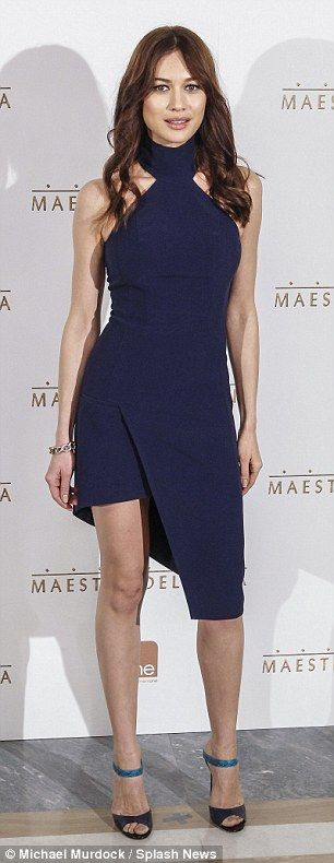 Stunning: Olga was stunning in a navy figure hugging asymmetrical dress that showed off he...