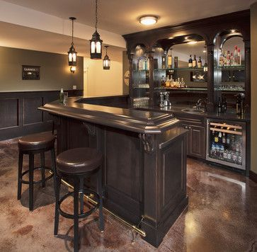 L shaped basement bar has corner cut off at an angle with wet sink and mini wine chiller - Basement bar layout ideas ...