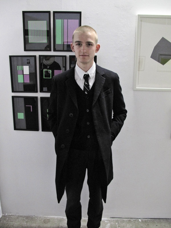 """Adrian Clement, """"Green and Purple Drawings, Volume 1"""". Artist Portrait with Adrian's art in the background, Factory 49, Group Print Show (on until 21 July 2012)."""