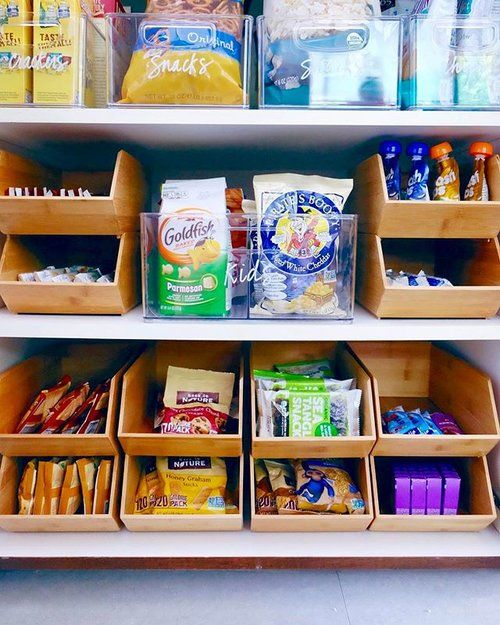 "Kids snack station on the bottom shelf for easy self-serve access. Obsessed with these new bamboo stackable bins! ✨ All products are available on our new SHOP page [thehomeedit.com/shop]! Just click on the image in ""shop the feed"" - or scroll down to shop all our favorite products at once. // You can also shop via screenshot using the new @liketoknow.it app // http://liketk.it/2rjAY ✨ #thehomeedit #pantry #organization"
