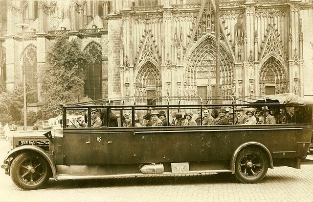 Sightseeing in London... A full open top tourist bus passes by Westminster Abbey 1920-London, as popular then as today!