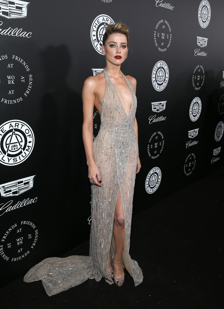 Amber Heard wears a silver tulle wrap dress, fully embroidered with silver threads, beads and crystals, from the GEORGES HOBEIKA Autumn/Winter 2017/2018 Couture Collection to the Art of Elysium's 11th Annual Celebration with John Legend at Barker Hangar. #GEORGESHOBEIKA #Amberheard #autumnwinter #hautecouture #artofelysium