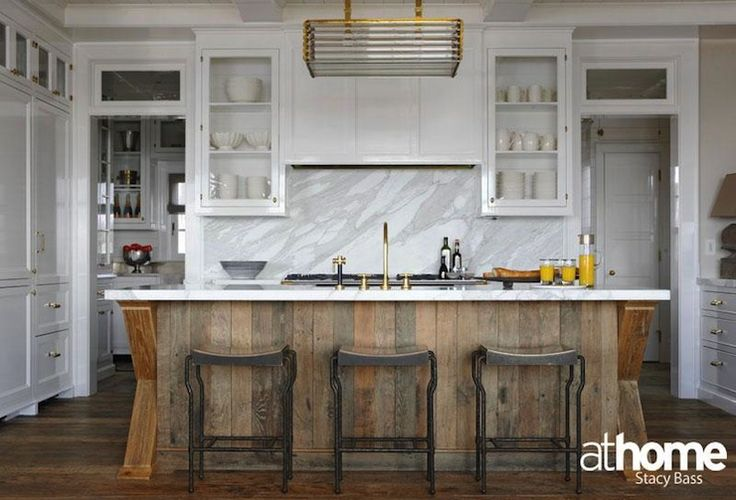 Modern two-tone kitchen design with glossy white shaker perimeter cabinets paired with salvaged wood center island.