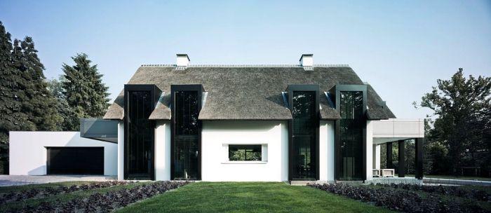 Afbeelding van http://cdn1.welke.nl/photo/scale-700xauto-wit/huis-ontworpen-door-Bob-Manders.1349705565-van-Sterrebb.png.
