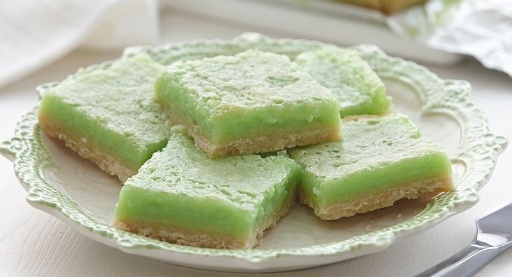 Lemon-Lime Bars (from McCormick) -- Crust: 1c flour, 1/3c powdered sugar, 1/2t ground ginger, 1/4t salt, 1/2c cold butter, cut into chunks; Lemon-Lime Filling: 1 1/4c sugar, 2T flour, 1/2t baking powder, 1/2c fresh lime juice, 3 eggs, lightly beaten, 2t lemon extract, 4 drops green food color. Makes a 9x9 pan.