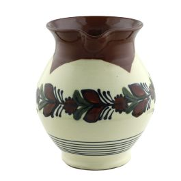 "Carefully handmade from glazed Baia Mare ceramic, this jug brings to our days the tradition of well-made things, which come to fruition through the artistry and passion of the potter craftsmen. Also, the product is customized with text ""Romania on the lower side to certify its authenticity.The Baia Mare ceramic is remarkable for its auburn clay and extremely shiny glaze, making this little bell an exquisite present, extremely valuable and authentic, made in Romania."