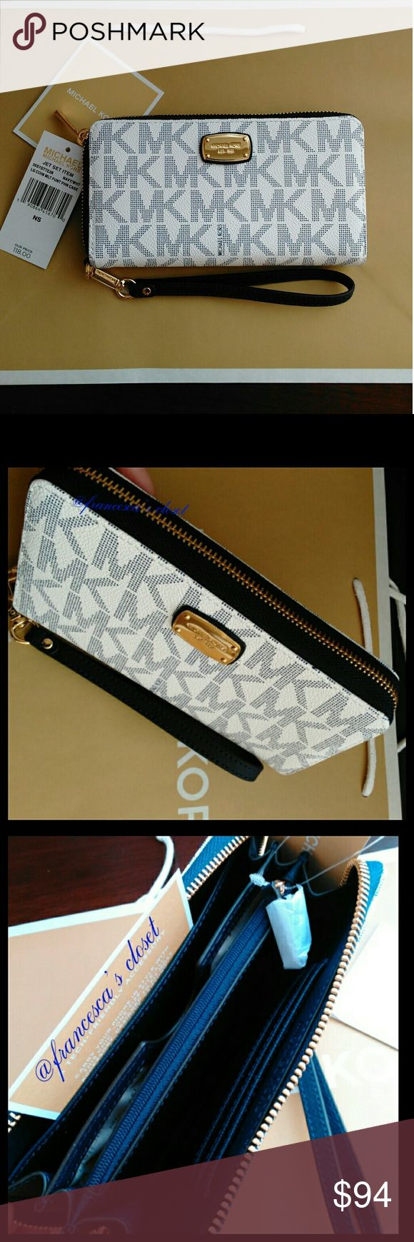 """Michael Kors Jet Set Large Phone Wallet new 100% Authentic. Brand new with tag attached. Navy/White MK Monogram with gold tone hardware. Measurements L 7"""" H 4"""" W 1"""" Smoke/pet free home. Comes with MK paper bag. Price is firm. Michael Kors Bags Wallets"""