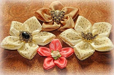 Ribbon Flower.  Romantic with satin and rhinestones or cute & youthful with grosgrain & button or pompom centers.  Bow Dazzling Volunteers, add an alligator clip with a felt circle for a sweet hair or headband accessory.
