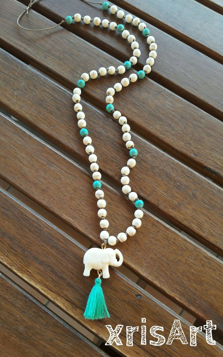 Handmade necklace in bohemian style with elephant and semiprecious stones