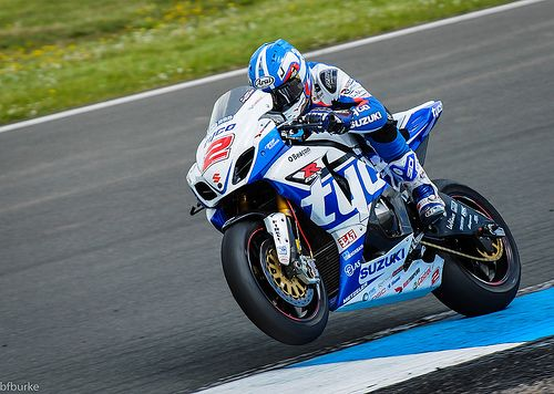 On with the power.  Josh Brookes powers into a wheelie as he straightens out of a corner on his Tyco Suzuki Superbike.