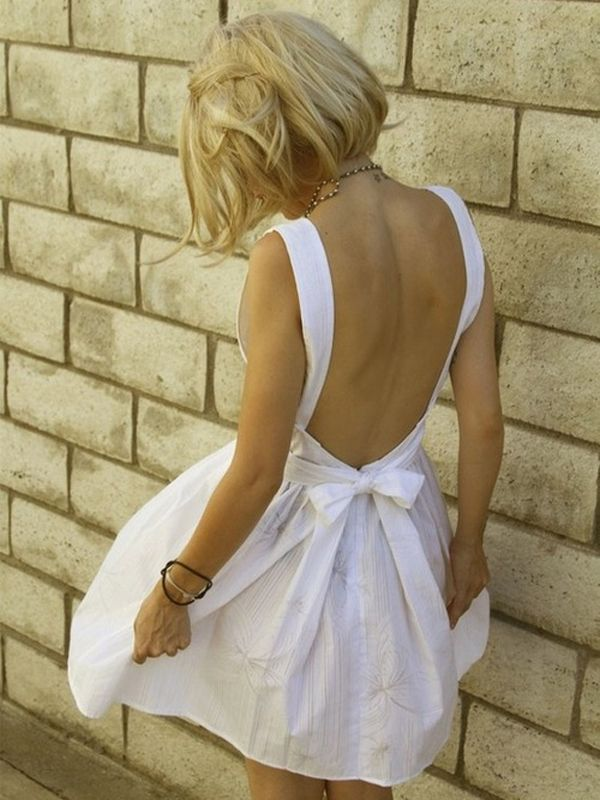 backless white dress with a bow