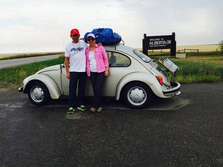 """Great News! Our new friends, Mr. and Mrs. Lopez have made it to Canada! They were on their way to Alaska from Monterrey, Nuevo Leon, Mexico in their 1967 Volkswagen Beetle. They stopped by our Slug Bug Car Show on Saturday and visited with us before heading out on the road again. Here are some pictures of them in Calgary and from this weekend when they won the """"Furthest Traveled"""" trophy! We wish them safe travels as they continue their amazing journey! #StreetVolkswagen #Volkswagen #Beetle"""