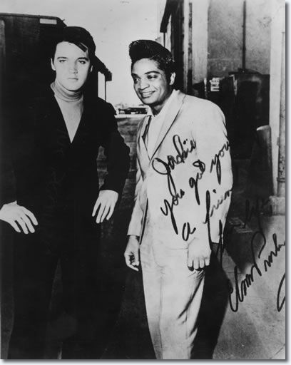 "In Elvis' own words: 'I heard this guy in Los Vegas - Billy Ward and the Dominoes. There's a guy out there who's doin' a take-off of me; 'Don't Be Cruel'. He tried so hard, till he got much better, boy; much better than that record of mine ...  ""A lot of people have accused Elvis of stealing the black man's music, when in fact, almost every black solo entertainer copied his stage mannerisms from Elvis."" - JACKIE WILSON.  (Elvis and Jackie Wilson) (circa 1966)"